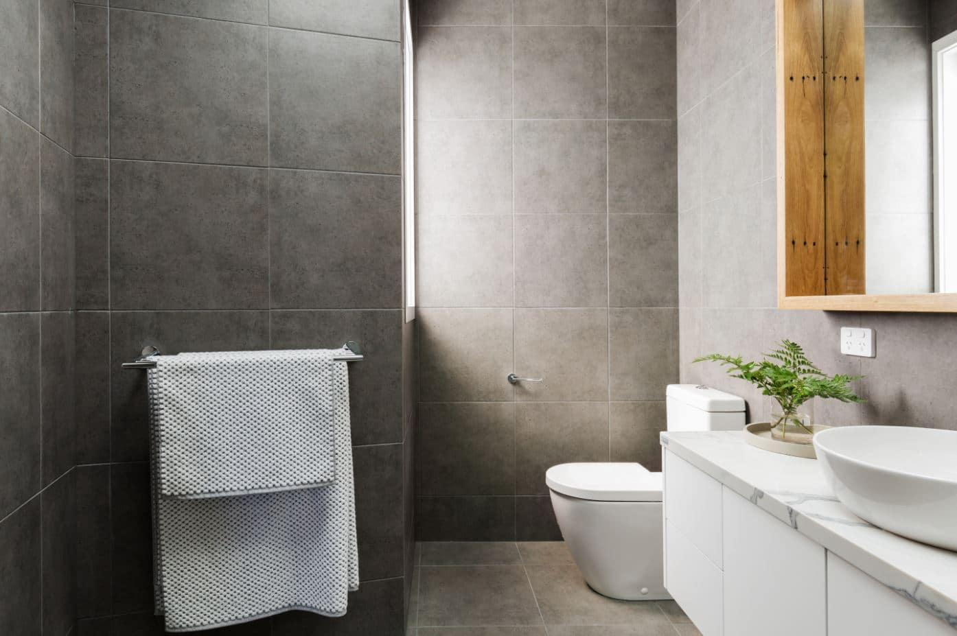 Bathroom renovation in Western Sydney with a charcoal grey design